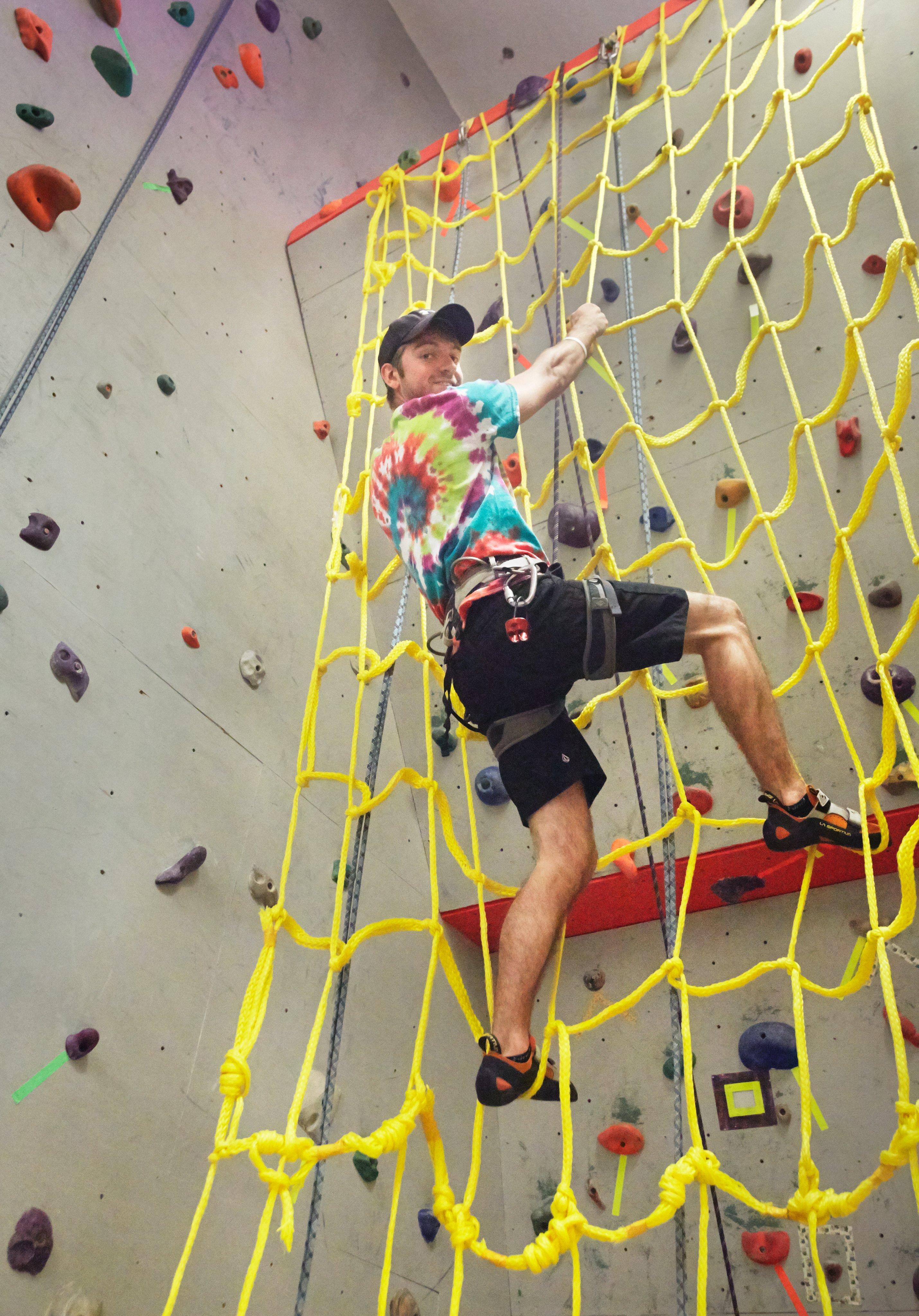 instructor on rock climbing net