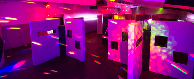 laser tag room with bright lights and obstacles