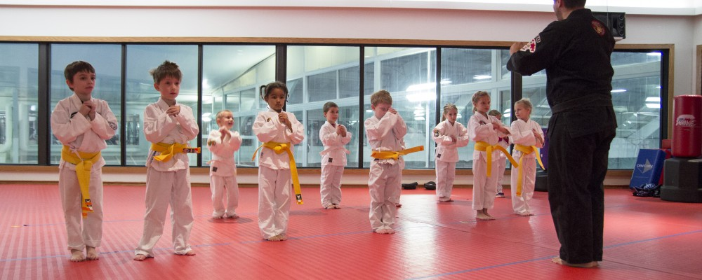 kids doing karate with instructor